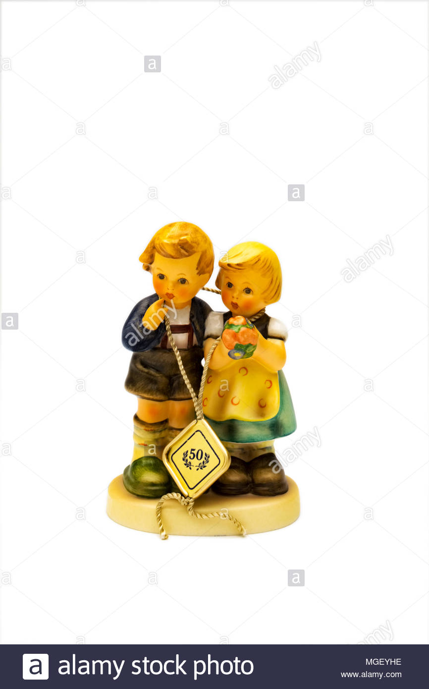 50th anniversary Hummel figurine of boy and girl with bouquet of flowers - Stock Image