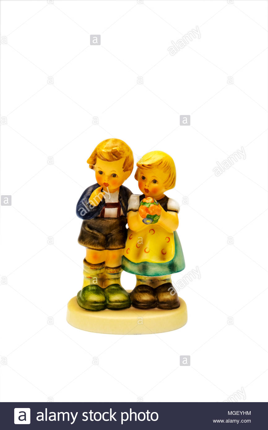 Hummel figurine of boy and girl with bouquet of flowers Stock Photo