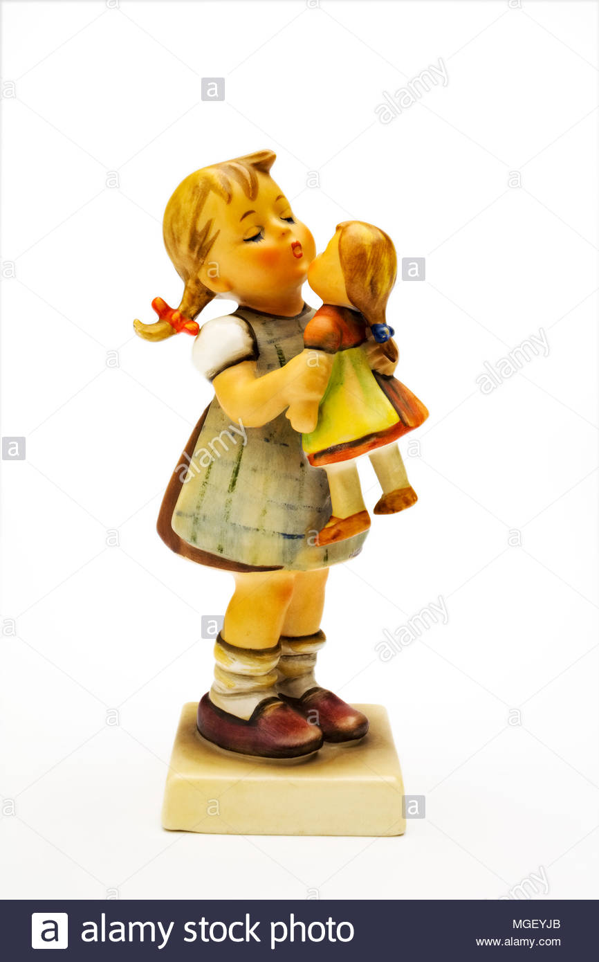 Hummel figurine of girl with doll Stock Photo