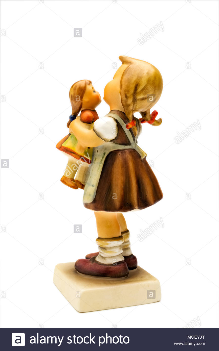 Hummel figurine of girl with doll - Stock Image