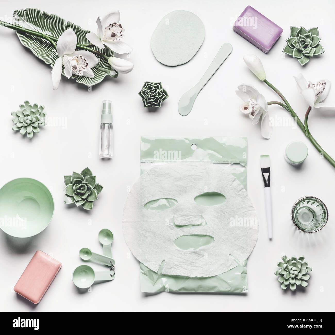 Green skin care cosmetic setting with orchid flowers, accessories ...
