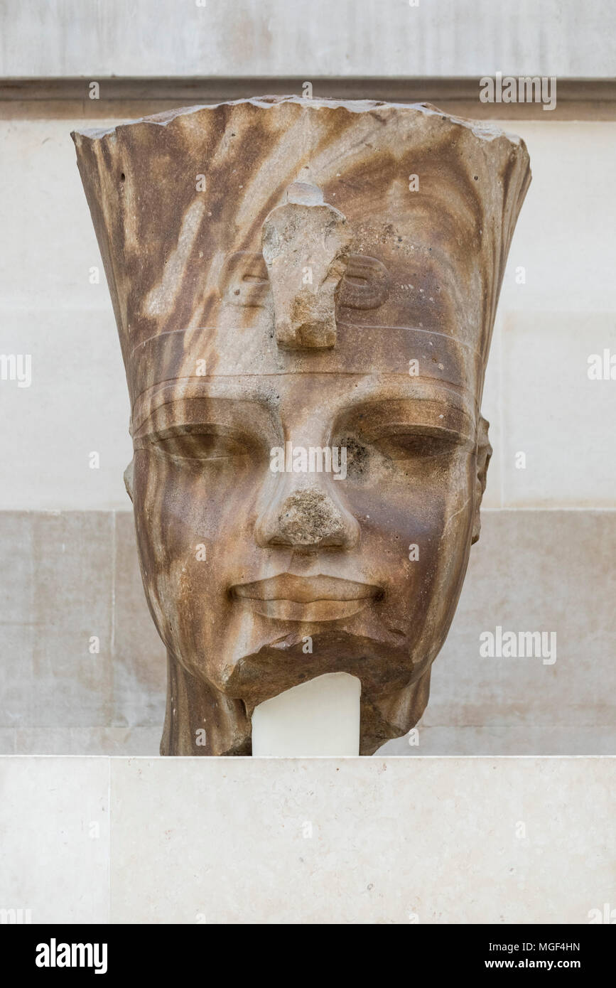 London. England. British Museum. Quartzite head of Egyptian Pharaoh Amenhotep III wearing the Red Crown of Lower Egypt (Deshret) with uraeus Stock Photo