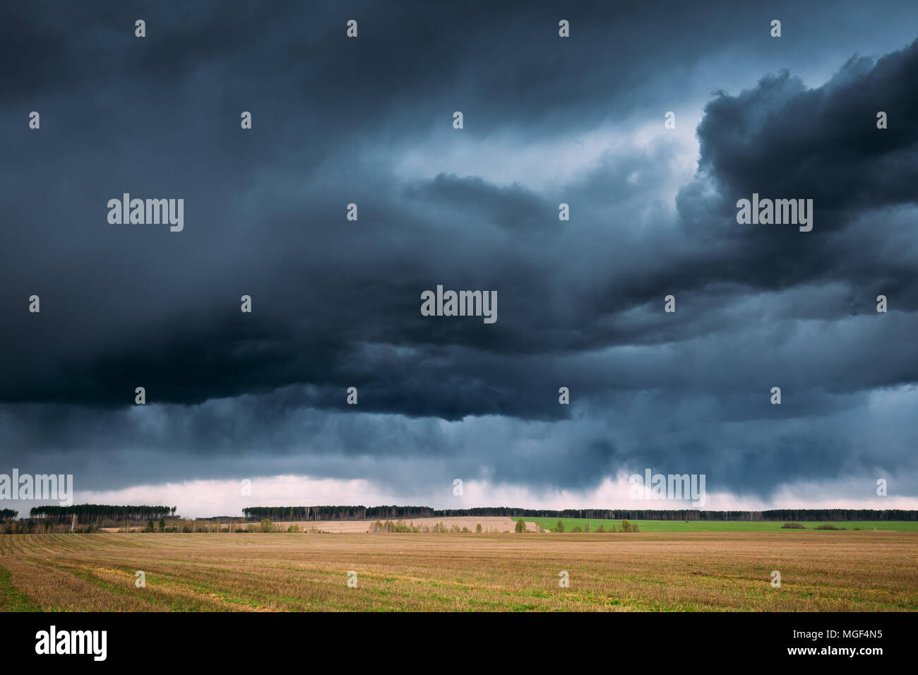 Countryside Rural Field Spring Meadow Landscape Under Scenic Dramatic Sky Before Rain. Rain Clouds On Horizon. Agricultural And Weather Forecast Conce - Stock Image