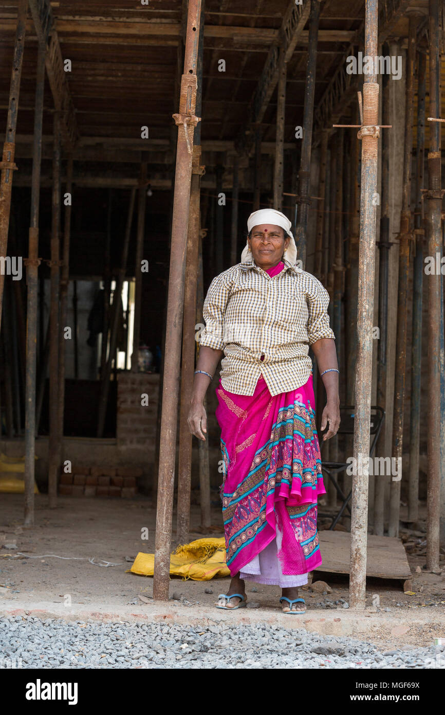 PUDUCHERY, PONDICHERY, TAMIL NADU, INDIA - March circa, 2018. Portrait of unidentified woman smiling workers are employed in construction work to buil Stock Photo