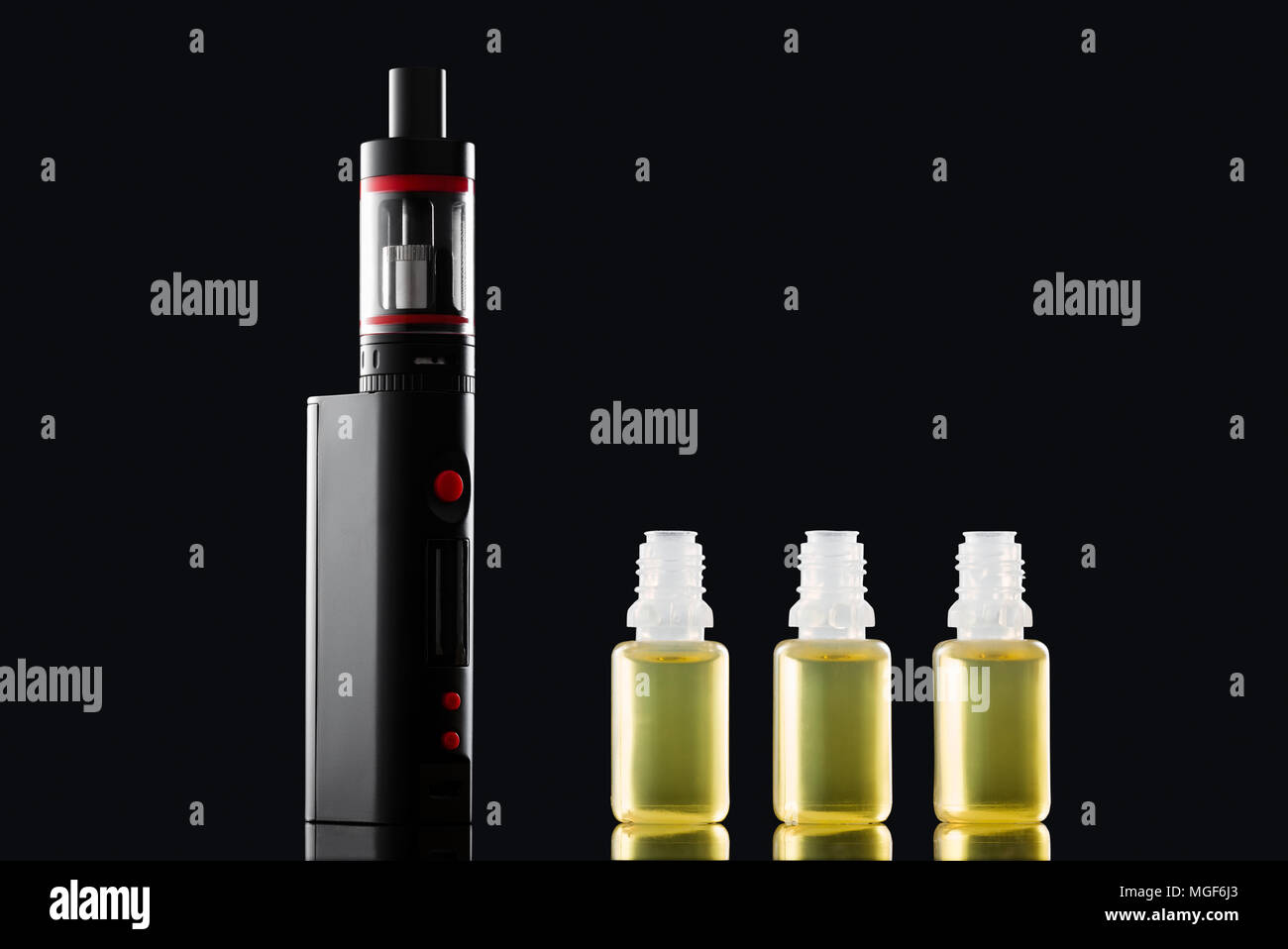 electronic cigarette and liquids - Stock Image