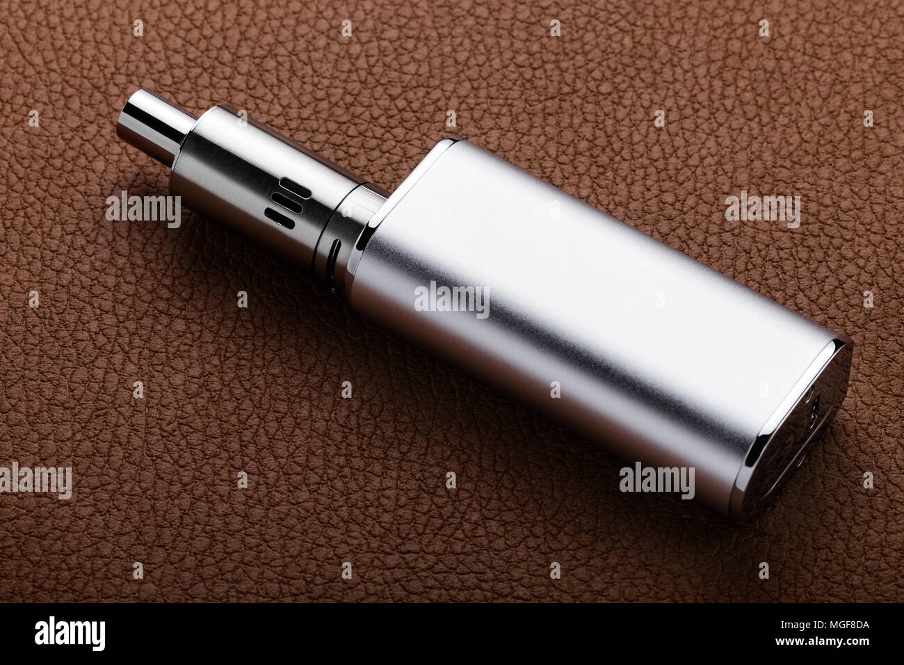 Electronic cigarette on leather background - Stock Image
