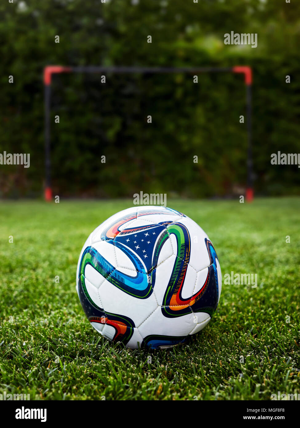 7ff7d8fb3 soccer ball on the grass field in front of a goal post Stock Photo ...