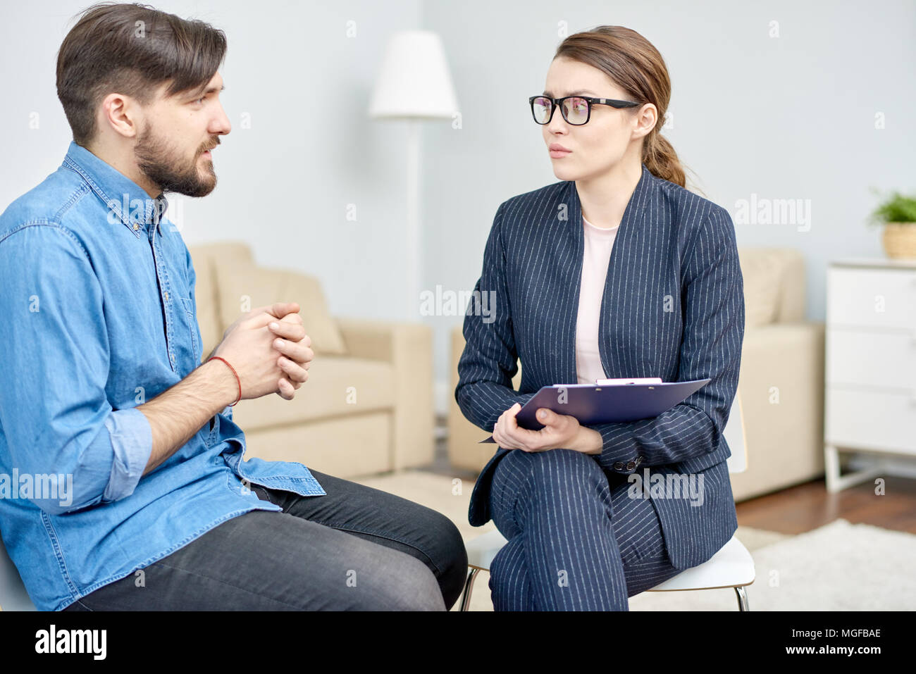 Handsome Bearded Man Suffering From Depression Having Consultation