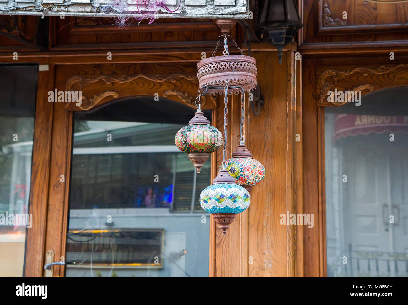 Traditional Multi Colored Glass Arabic Lamp Near The Wooden Front