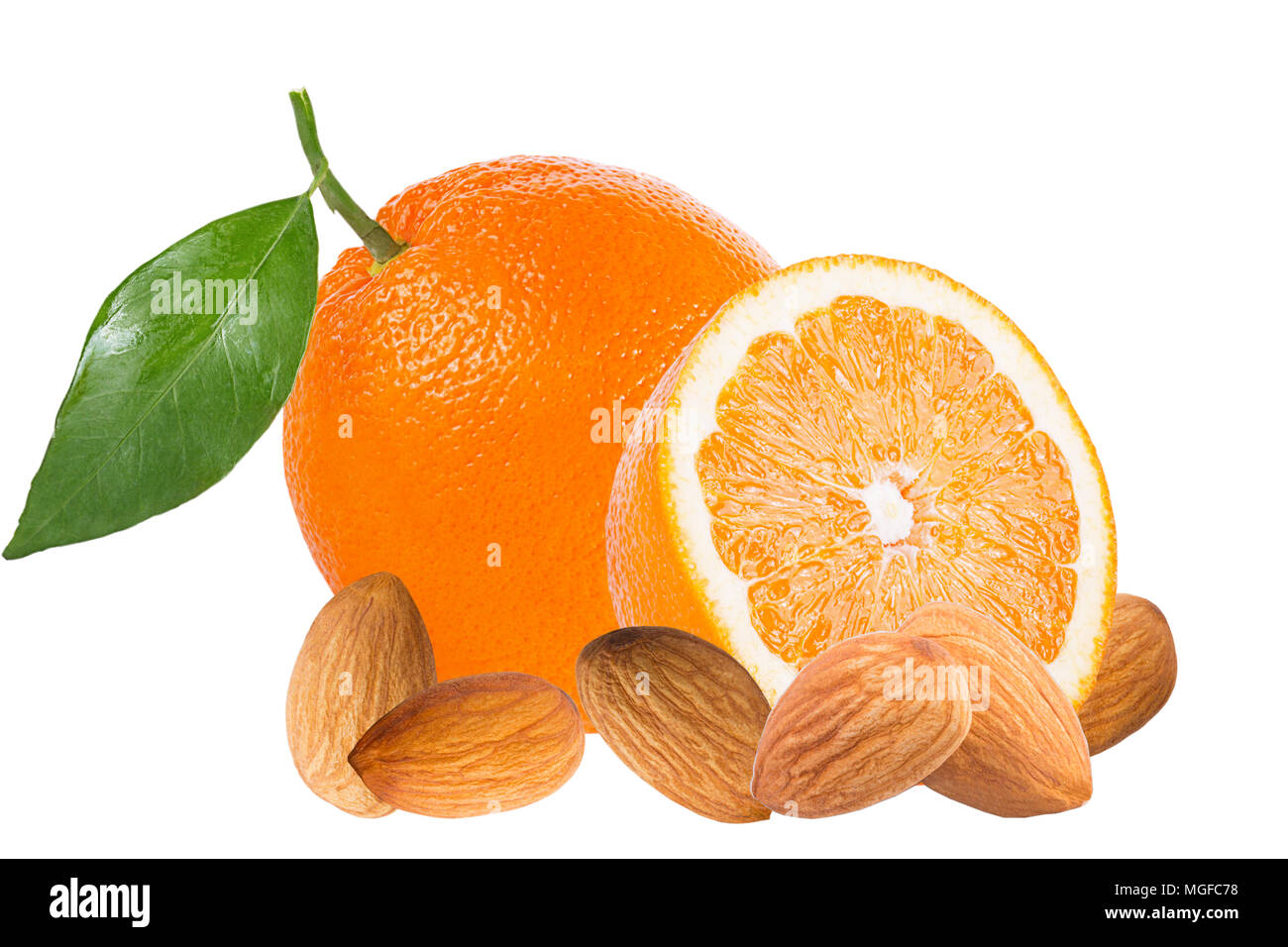 Isolated fruits. Fresh oranges and almonds isolated on white background with clipping path as packaging design element. - Stock Image