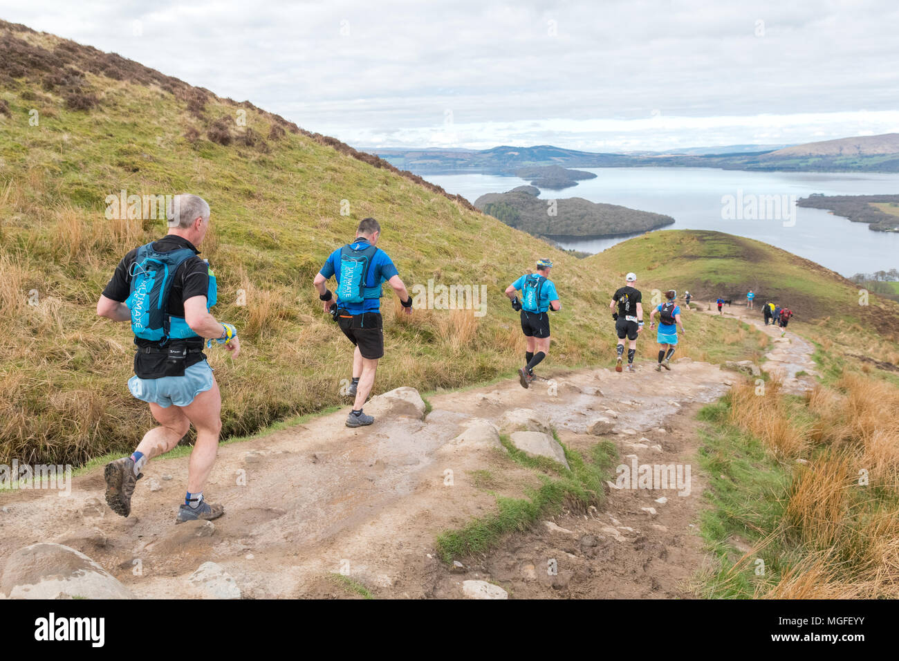 Conic Hill, Loch Lomond, Scotland, UK - 28 April 2018: The Highland Fling Race 2018 - competitors decending Conic Hill  hopefully had the opportunity to take in the stunning views of Loch Lomond  ahead.  The 53 mile Ultra Marathon follows the route of the West Highland Way through Loch Lomond and the Trossachs National Park, from Milngavie to Tyndrum Credit: Kay Roxby/Alamy Live News - Stock Image