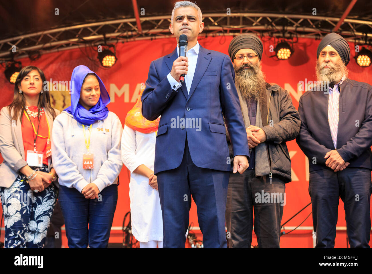 Trafalgar Square, London, 28th April 2018. The Mayor of London, Sadiq Khan, marks this year's Vaisakhi festival with a speech. Visitors and members of the Sikh and Punjabi community enjoy the popular Vaisakhi festival in Trafalgar Square, which features cultural performances, music, dance and stalls in the square. Vaisakhi festival is a celebration of Sikh and Punjabi tradition, heritage and culture, commemorating the birth of the Khalsa (the inner core of the Sikh faith) over 300 years ago. Credit: Imageplotter News and Sports/Alamy Live News - Stock Image