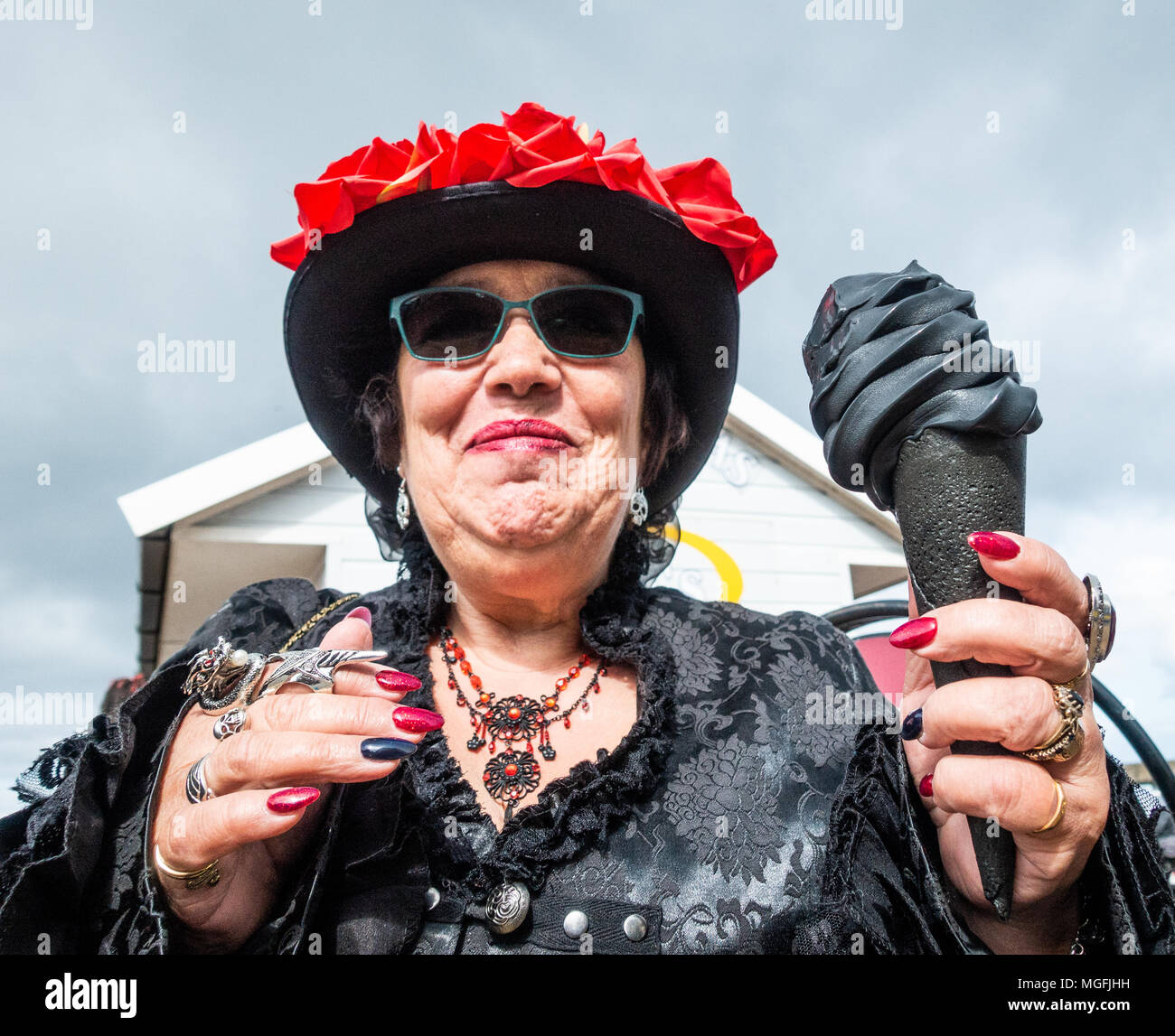 Whitby, North Yorkshire, England, UK, 28th April, 2018. Weather: Bright and chilly in Whitby  as thousands of Goths and Steampunks descend on the Yorkshire coastal town for  the famous Whitby Goth weekend: Despite the chilly weather, The jet black 'Whitby Jet' ice cream seemed to be the flavour of the day among Goths. Credit: ALAN DAWSON/Alamy Live News - Stock Image