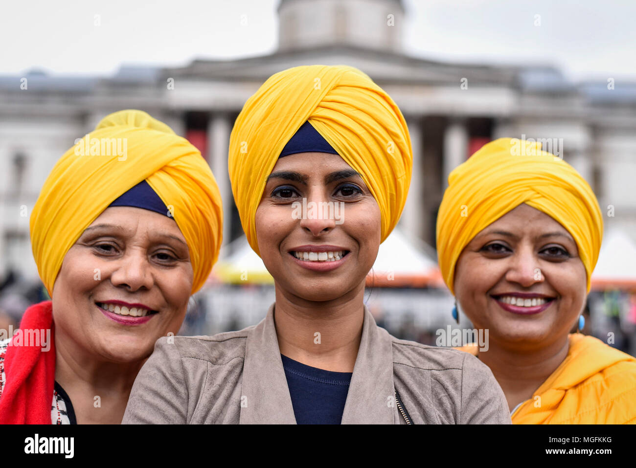 London, UK.  28 April 2018.  (L to R) Sue Khanna, Kanika Sachdeva and Kamaljeet Sandhu pose wearing turbans during the festival of Vaisakhi in Trafalgar Square, hosted by the Mayor of London.  For Sikhs and Punjabis, the festival celebrates the spring harvest and commemorates the founding of the Khalsa community over 300 years ago. Credit: Stephen Chung / Alamy Live News Stock Photo