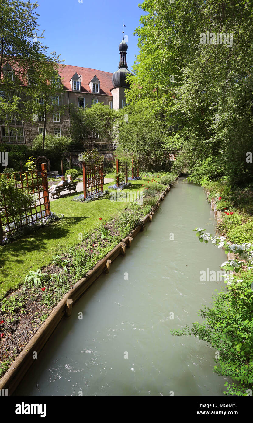 27 April 2018, Germany, Augsburg: A canal with water from the Lechs running along the herbal garden at the 'Red Gate'. The city of Augsburg has applied as 'Wasserbau und Wasserkraft, Trinkwasser und Brunnenkunst in Augsburg' (lit. hydarulic engineering, hydropower, drinking water and fountain art) for admission to the UNESCO world heritage list. Photo: Karl-Josef Hildenbrand/dpa Stock Photo