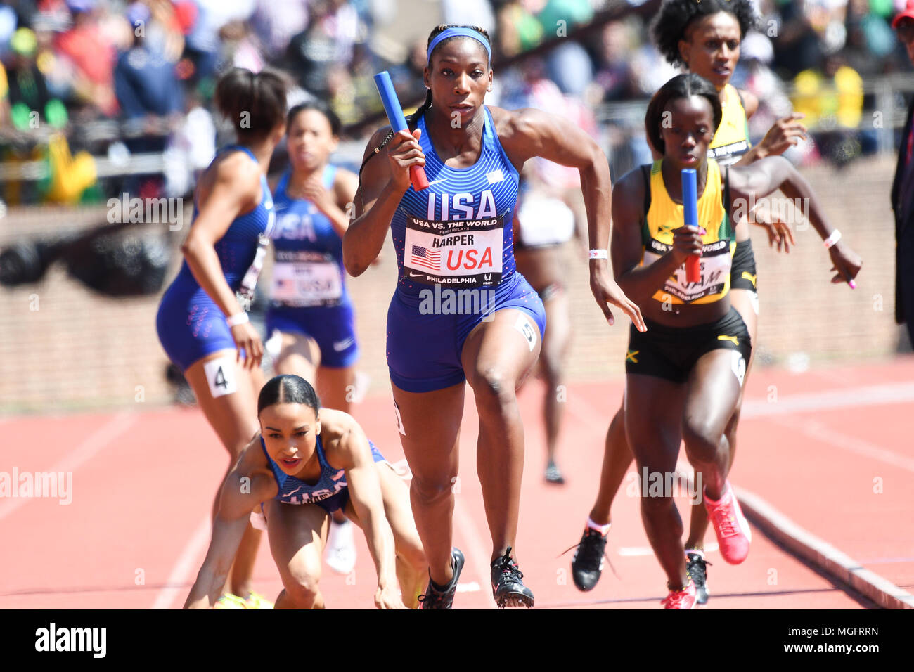 Philadelphia, Pennsylvania, USA. 28th Apr, 2018. KENDRA CHAMBERS of the USA falls as she passes the baton to DAINA HARPER, during the USA vs The World Women 4x400 at the 124th running of the Penn Relays in Philadelphia Pennsylvania Credit: Ricky Fitchett/ZUMA Wire/Alamy Live News - Stock Image