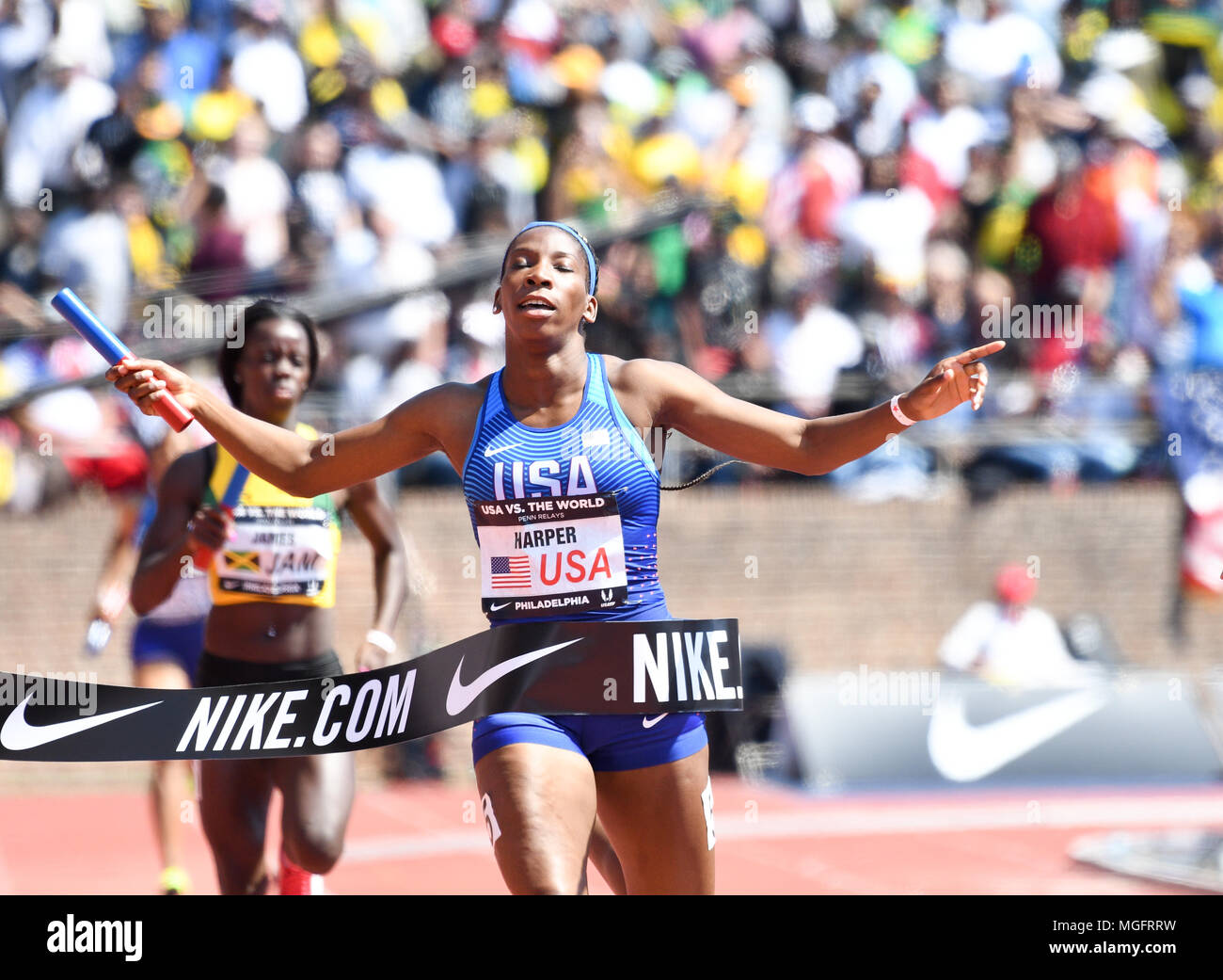 Philadelphia, Pennsylvania, USA. 28th Apr, 2018. DAINA HARPER, of the USA crosses the finish line first during the USA vs The World Women 4x400 at the 124th running of the Penn Relays in Philadelphia Pennsylvania Credit: Ricky Fitchett/ZUMA Wire/Alamy Live News - Stock Image