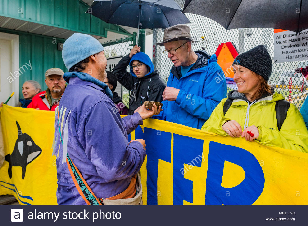 People of Faith, Christians, Moslems, Buddhists and Jews  join together with local Tsleil-Waututh First Nation to protest the Kinder Morgan Pipeline twinning and expansion, Burnaby Mountain, British Columbia, Canada. - Stock Image