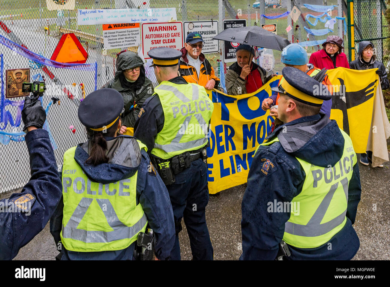 British Columbia, Canada. 28 April 2018. People of Faith, Christians, Moslems, Buddhists and Jews  join together with local Tsleil-Waututh First Nation to  block Kinder Morgan entrance, Burnaby Mountain, British Columbia, Canada. - Stock Image