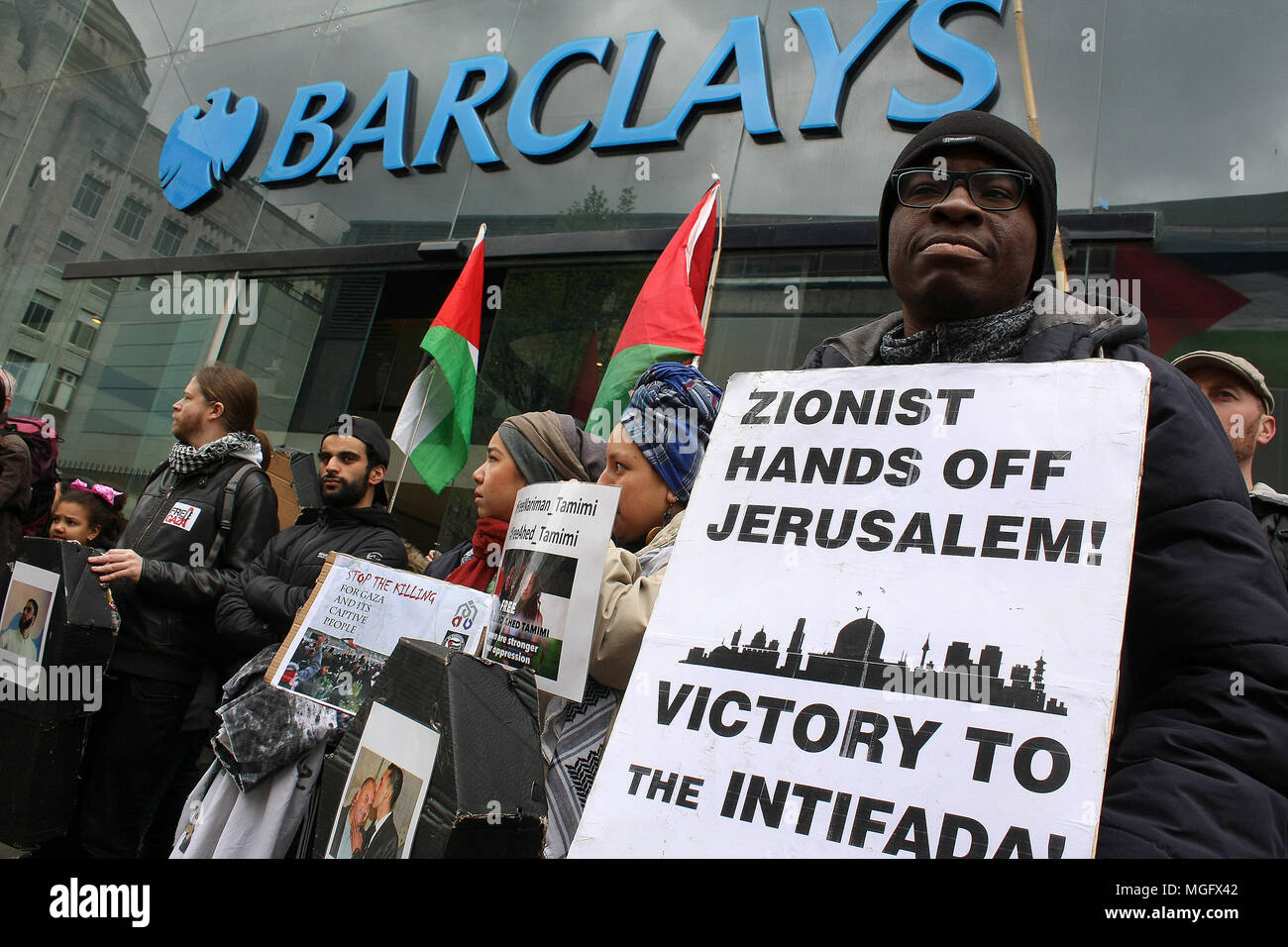Manchester, UK. 28 April 2018. Palestine Solidarity demonstrators picket Barclays Bank in the city of Manchester. The demonstrators were protesting for the rights of the people of Gaza and against the complicity of British firms and Banking Institutions who contribute either materially or financially to Israel and its arms trade. Credit: SOPA Images Limited/Alamy Live News - Stock Image