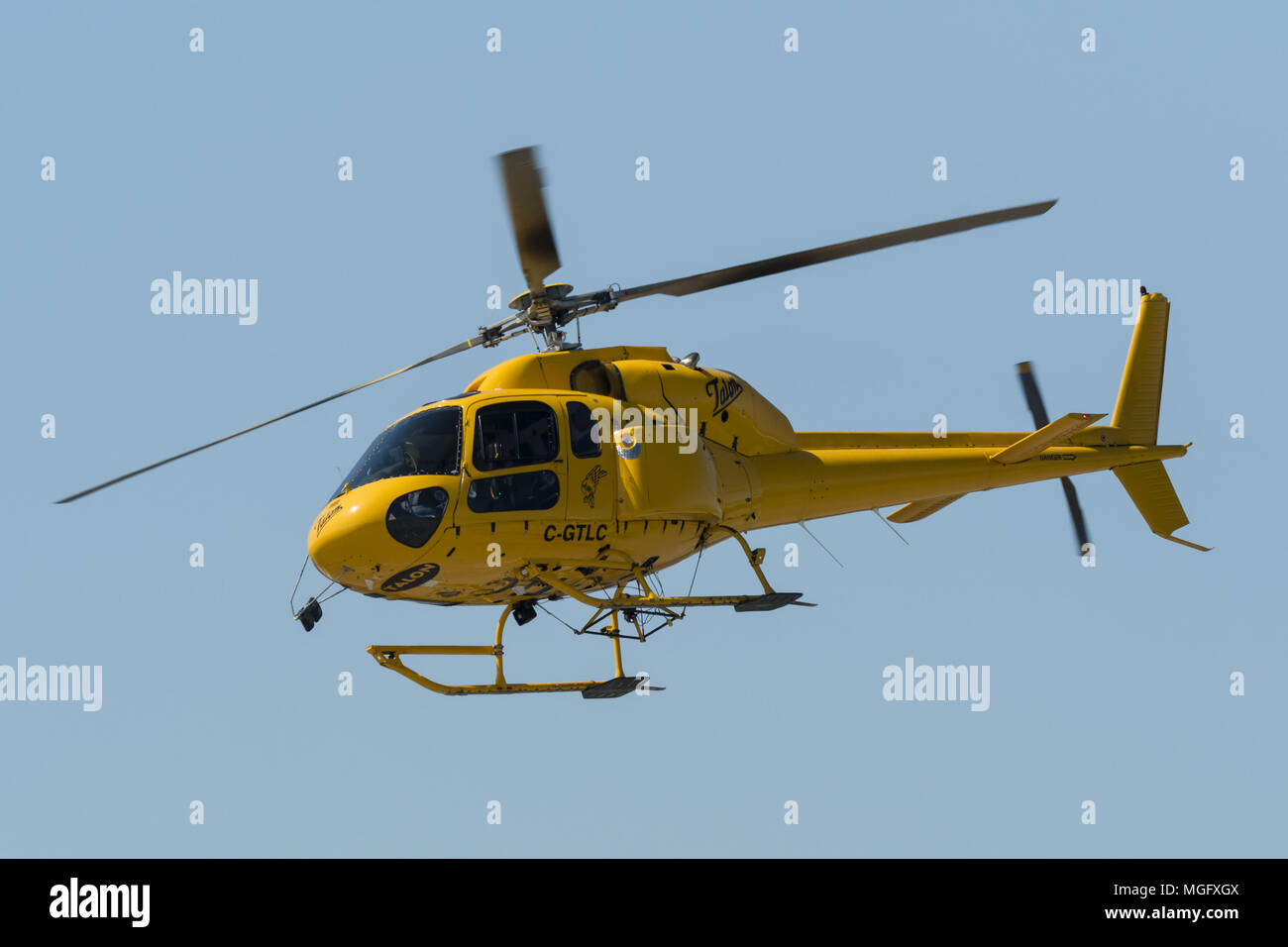 Richmond, British Columbia, Canada. 27th Apr, 2018. A Eurocopter AS355 Ecureuil 2 Twinstar helicopter (C-GTLC) belonging to Talon Helicopters Ltd. departs from Vancouver International Airport. Credit: Bayne Stanley/ZUMA Wire/Alamy Live News - Stock Image