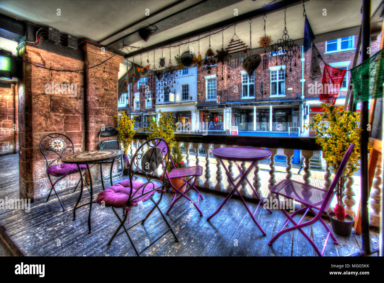 City of Chester, England.  Artistic view of a café on Bridge Street Rows, with Bridge Street pedestrian precinct in the background. - Stock Image