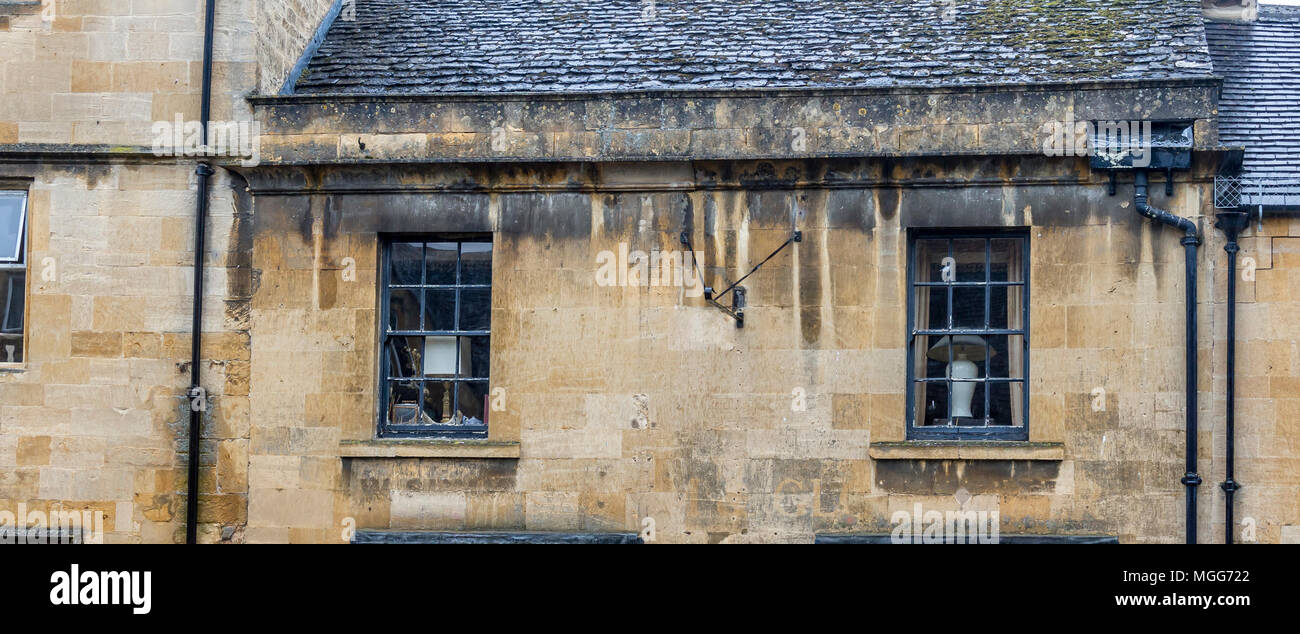 Cotswold limestone adorns the facade of this elegant terraced house in the picturesque market town high street of Chipping Campden Stock Photo