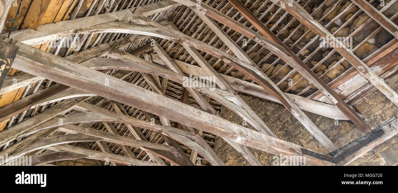 The oak beamed roof of Chipping Campden's open Market Hall was built in 1627 by Sir Baptist Hicks to shelter the cheese, butter and poultry market - Stock Image