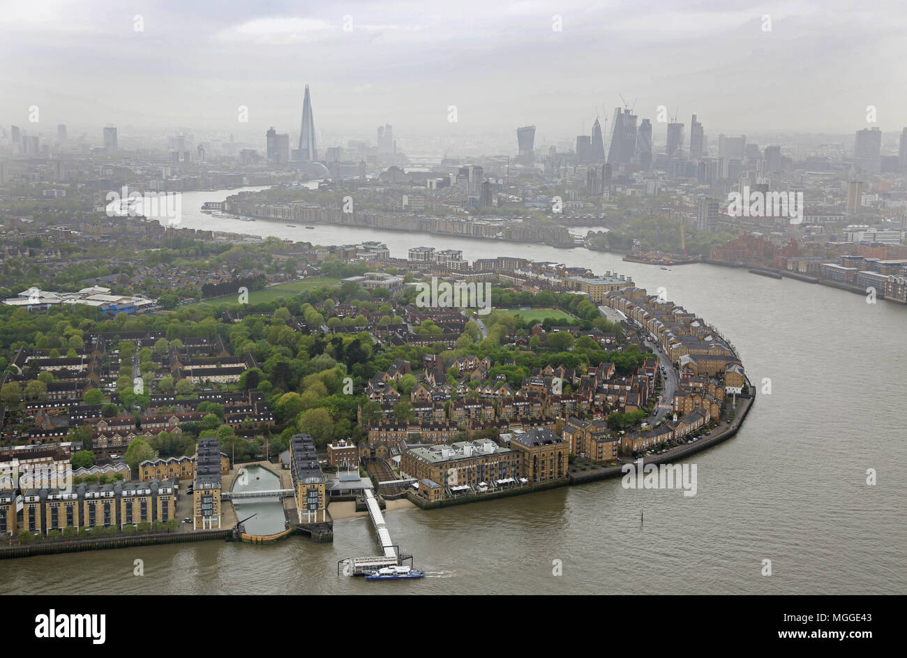 High level view of the River Thames from Canary Wharf looking towards the City of London. Overcast April morning. Shows Rotherhithe in foreground. - Stock Image