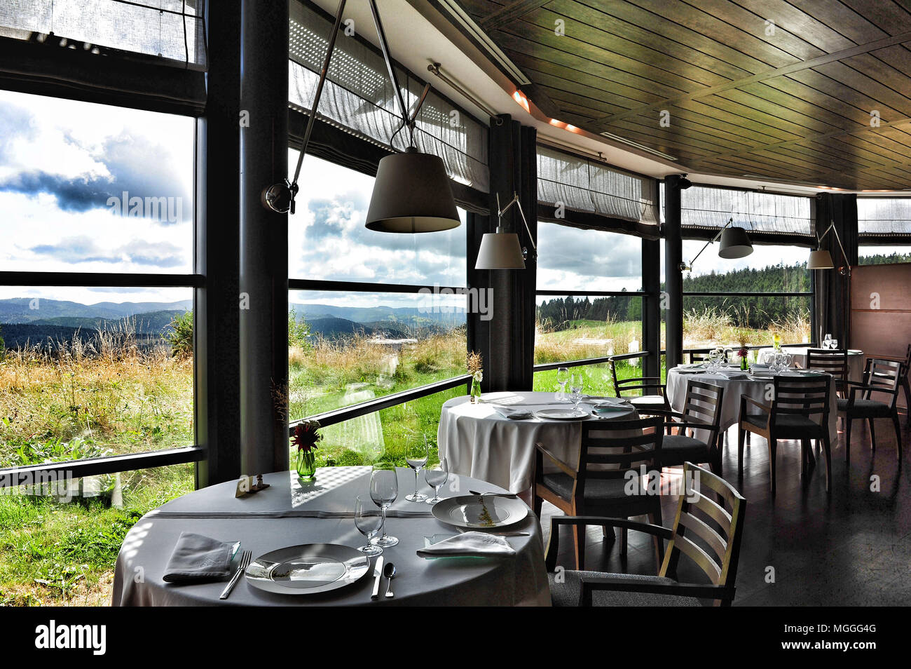 Fine dining with a view over the Auvergne countryside at Michelin three-starred Régis et Jacques Marcon restaurant in Saint-Bonnet-le-Froid, France - Stock Image