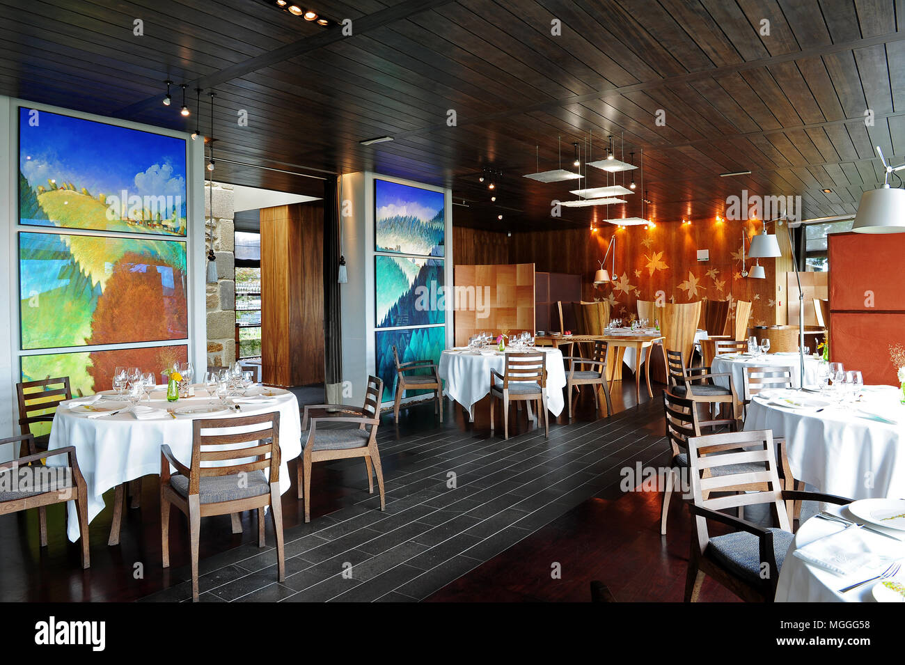 The dining room of Michelin three-starred Régis et Jacques Marcon restaurant in Saint-Bonnet-le-Froid, France - Stock Image