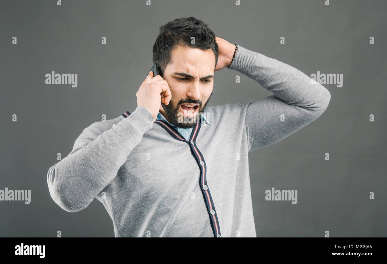 Man Angry with Phone - Stock Image