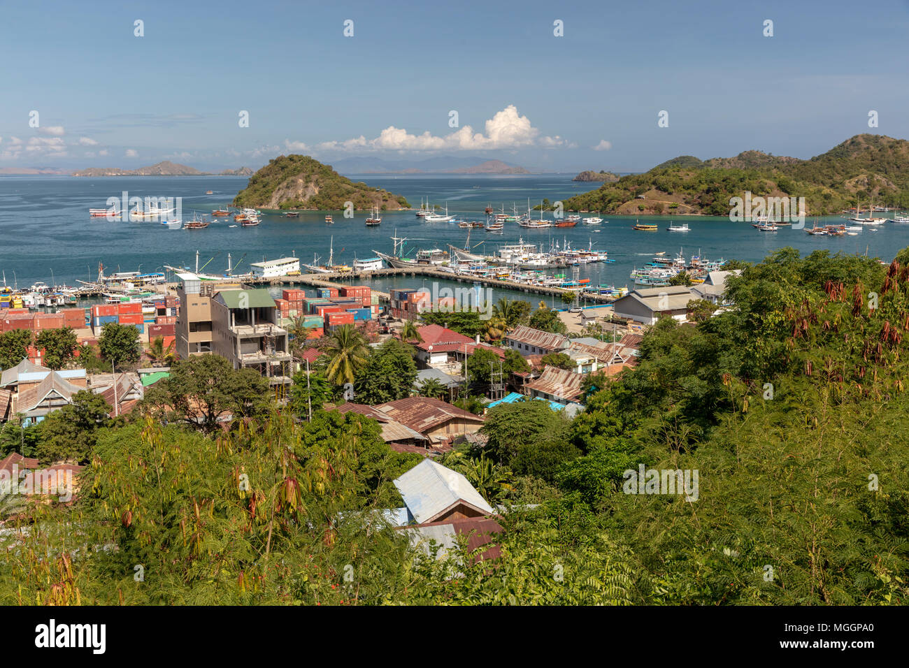 View of harbor at  Labuan Bajo, Indonesia from hillside above town - Stock Image