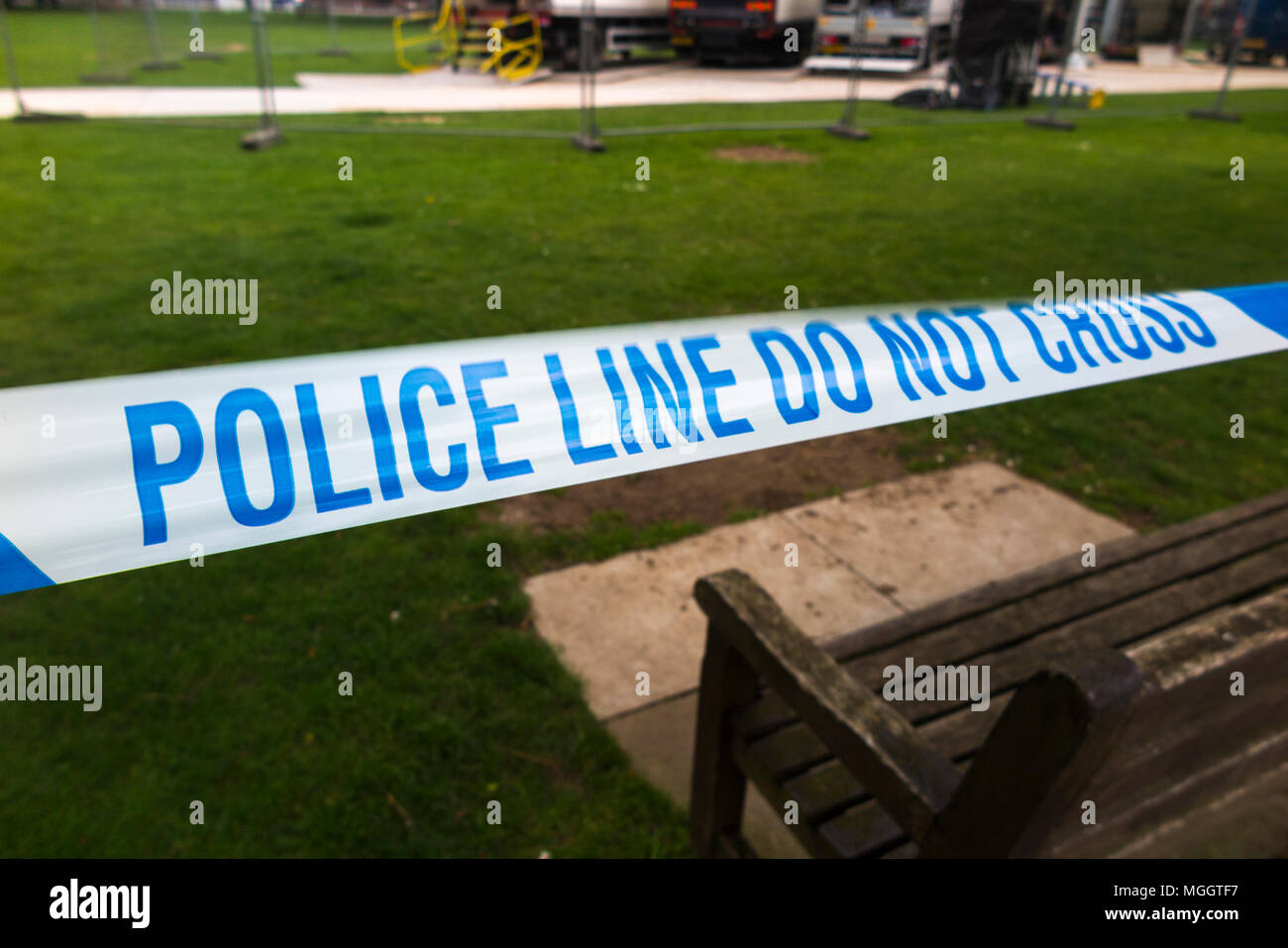 Police Line Do Not Cross tape barrier, typically placed around a crime scene by police officers or scene of crime officer / crimes officers. UK. (96) - Stock Image