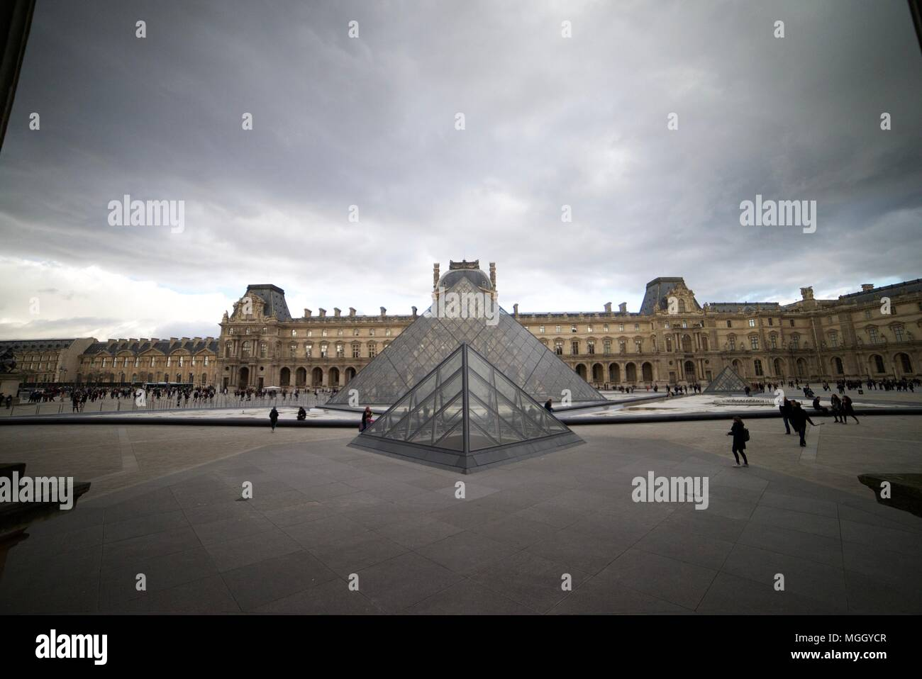 The Louvre Palace and Museums (Glass pyramid's outside La Louvre, Paris) - Stock Image
