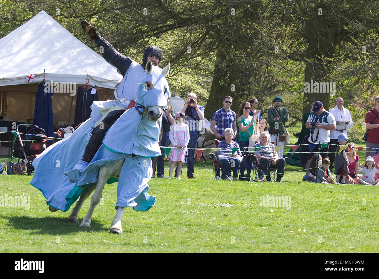 The kings Knights showing off equestrian skills at the royal joust - Stock Image