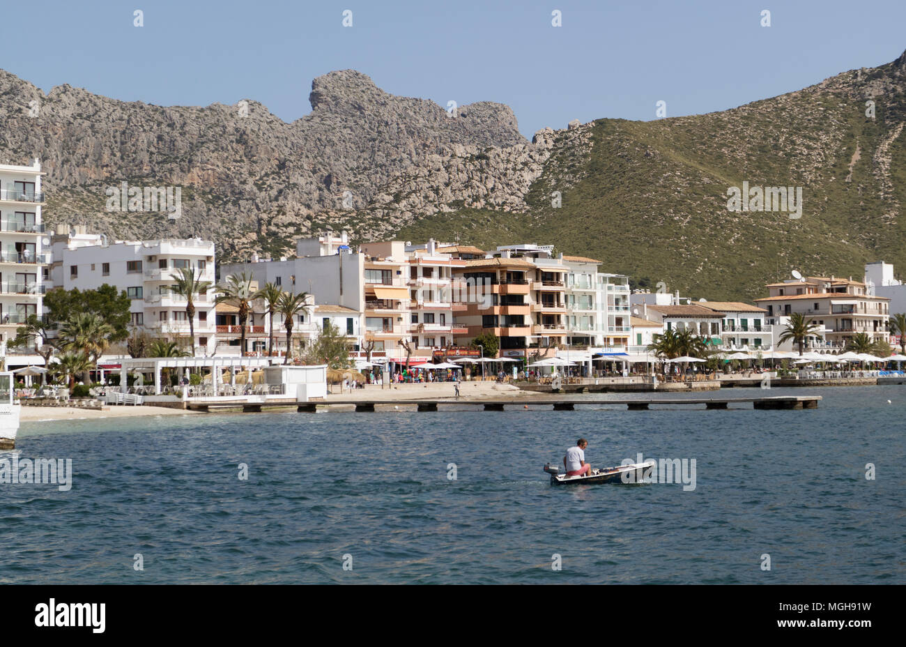 Port of Pollenca, Mallorca, Spain. 2018.  Shops, apartments and hotels overlookingBay of Pollensa. - Stock Image