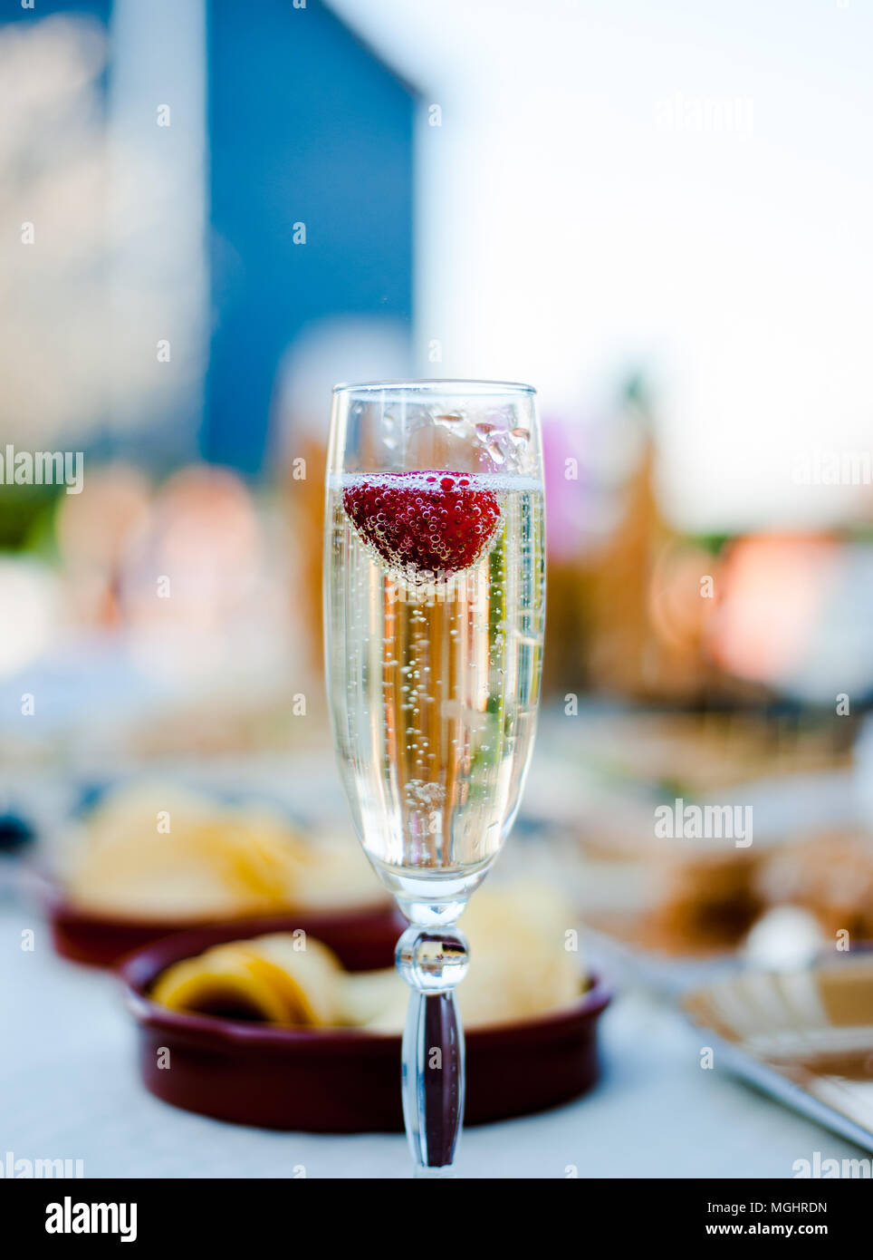Close up a glass of champagne with strawberry - Stock Image