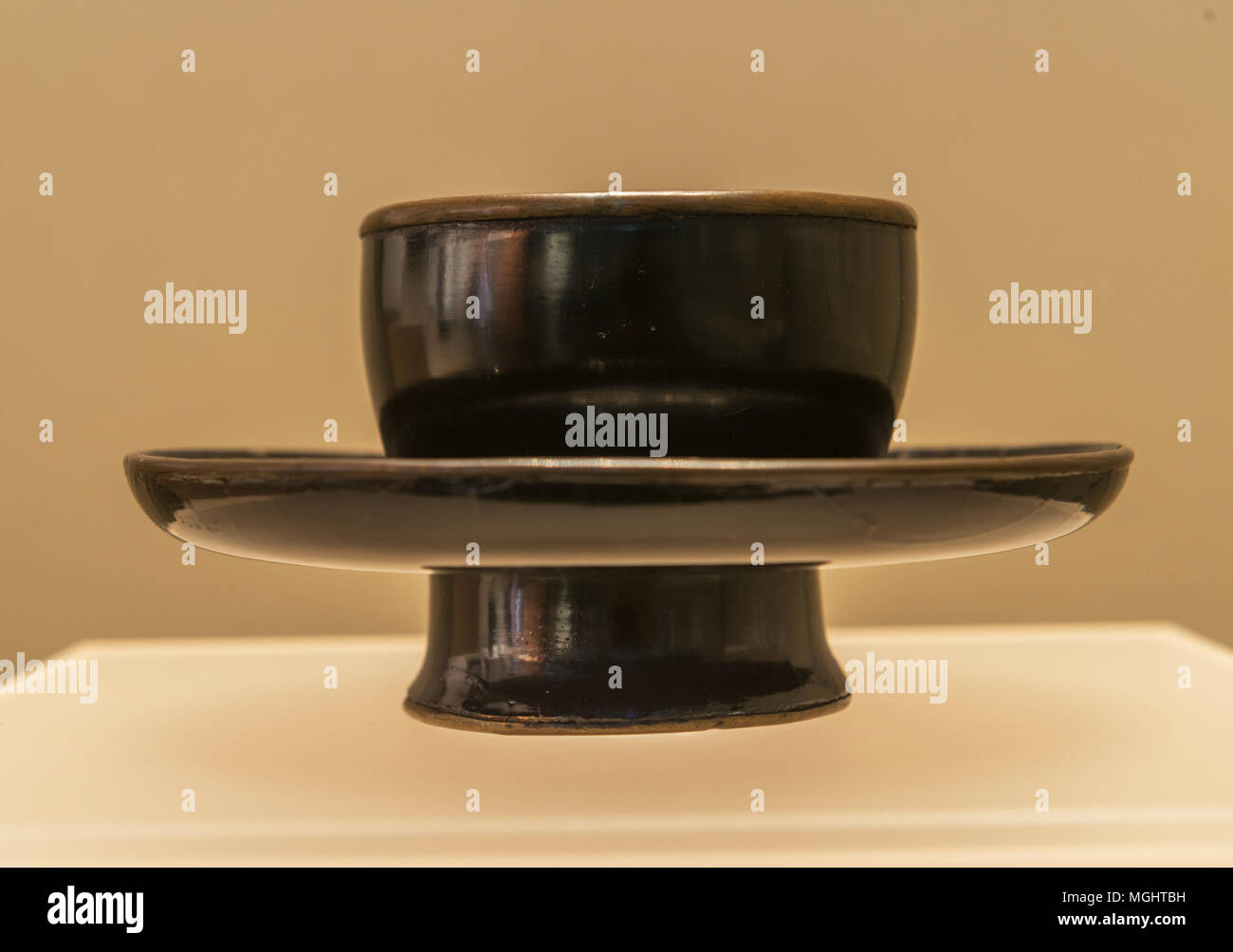 Black lacquer bowl stand from Song or Yuan dynasty, donated by Hong Kong entrepreneurial couple Cao Qiyong and Luo Bizhen to the Zhejiang Museum. - Stock Image