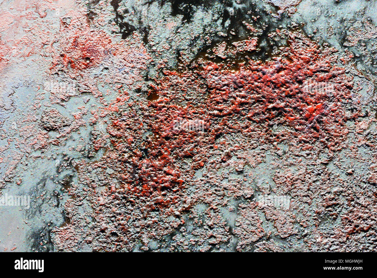 Congealed blood gunk and stained rust effect with dry flecks of organic matter and dark red and black stains Stock Photo
