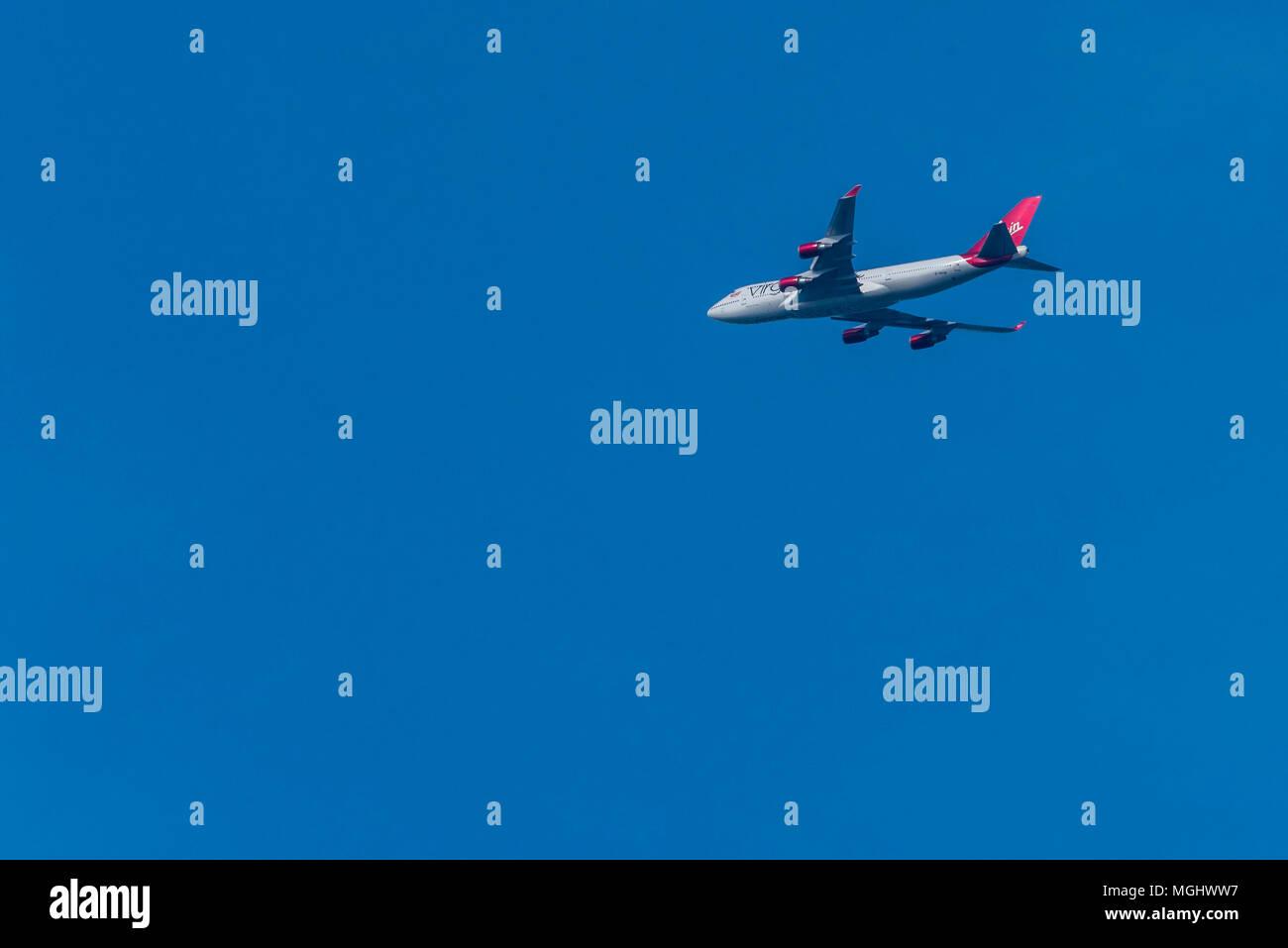 Virgin Atlantic jumbo jet Boeing 747 Big blue sky Stock Photo