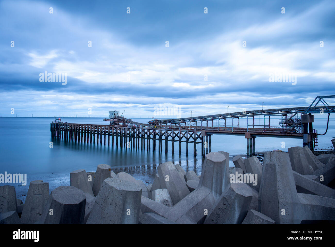 Raynes Quarry and jetty with sea defence in Llanddulas North Wales UK - Stock Image