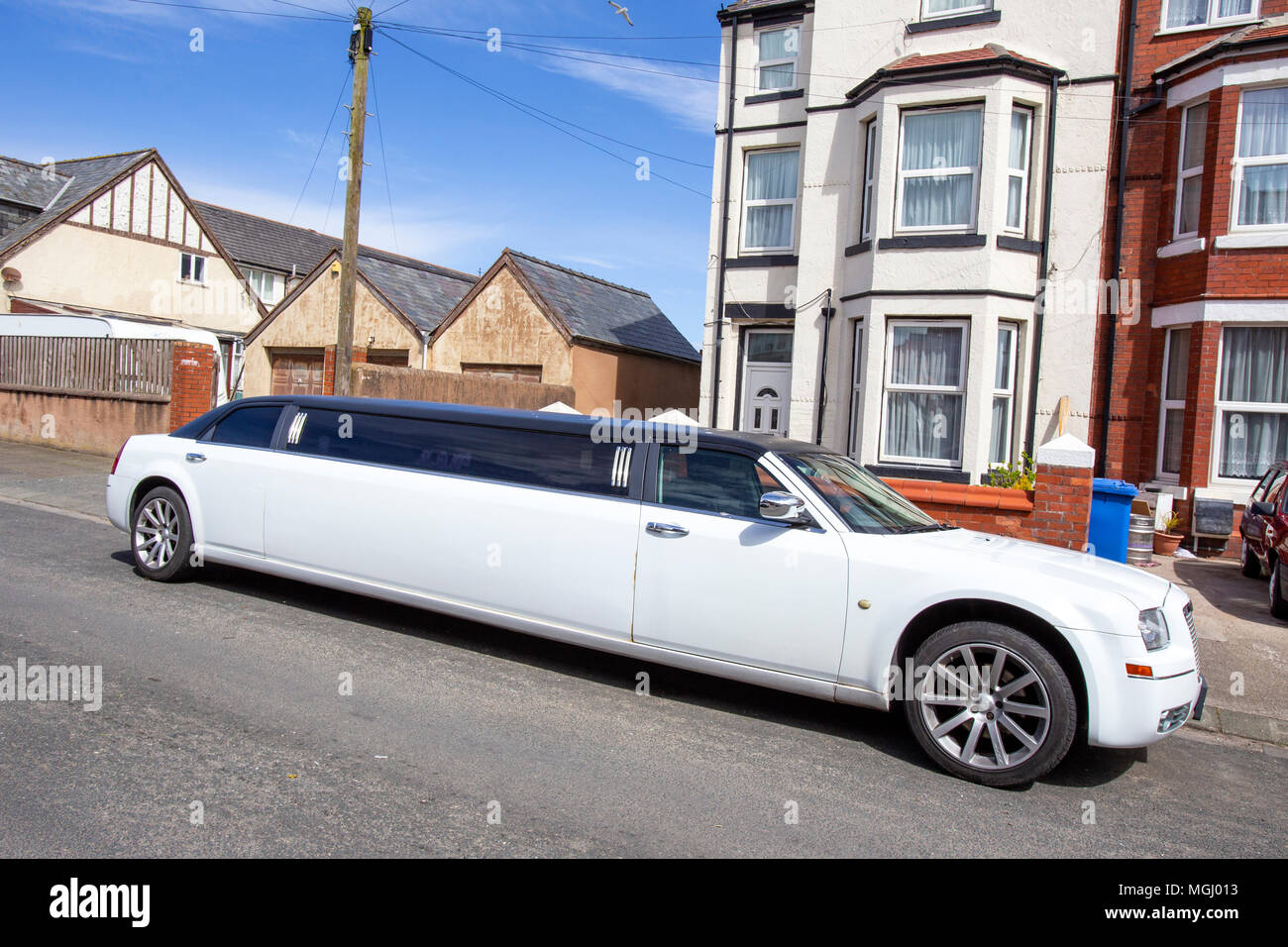 White streched limousine in Rhyl Denbighshire Wales UK - Stock Image