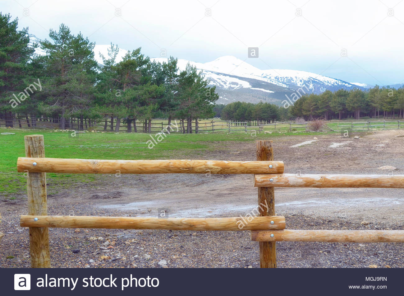 Weather In Guadarrama Mountain Range Madrid Spain Forefront Of Natural Wood Mountain Fence Wintry Day In Spring Season