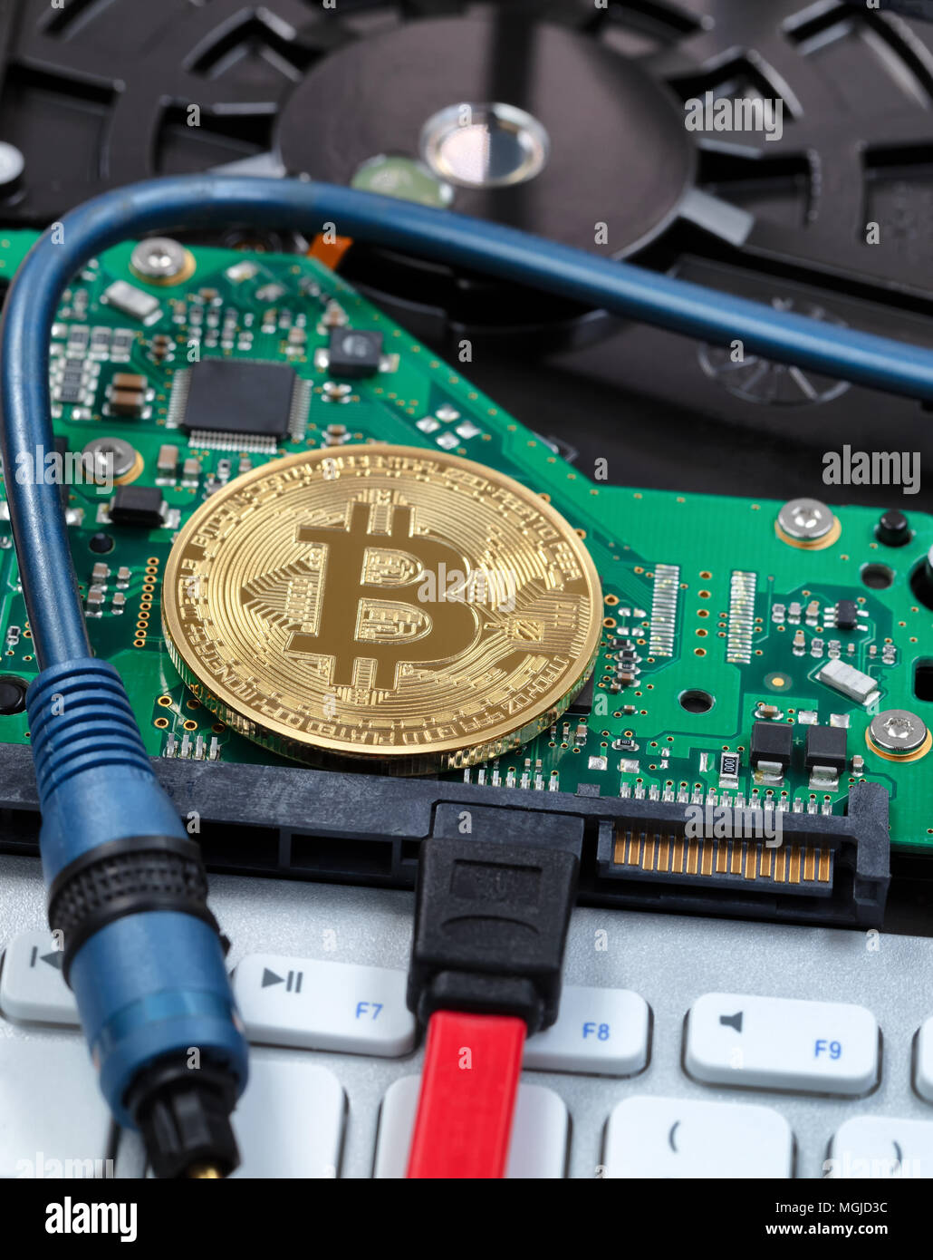 Close up view of cyber currency with modern computer technology - Stock Image