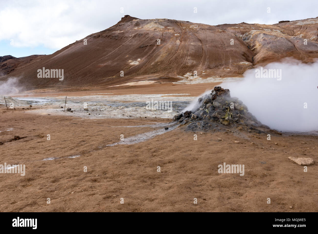Hverir, steam vent and the hills behind - Stock Image