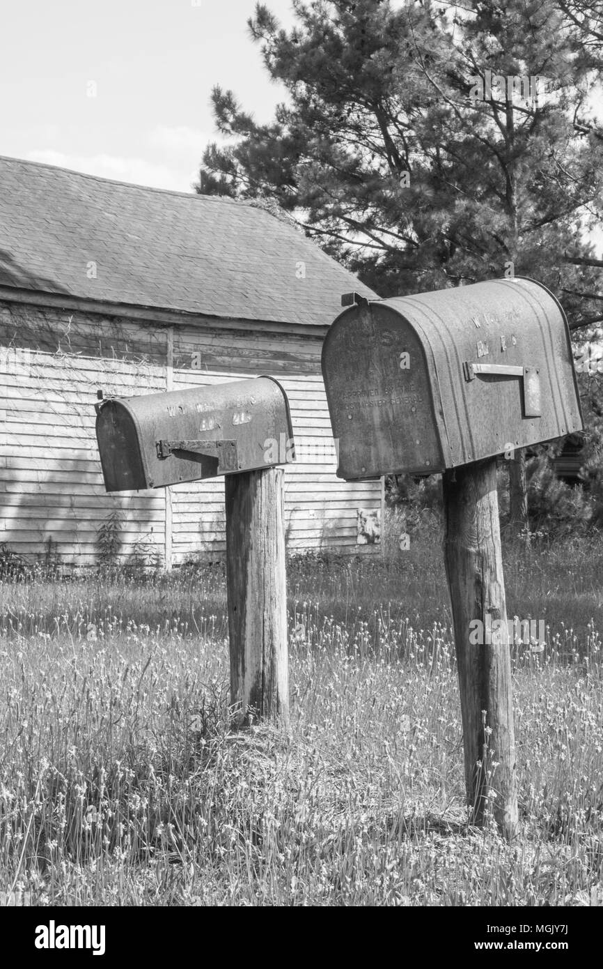 Vintage scene from days gone by. Drive the country roads and see rusted mailboxes, old gas pumps, and wooden buildings that housed long forgotten folk Stock Photo