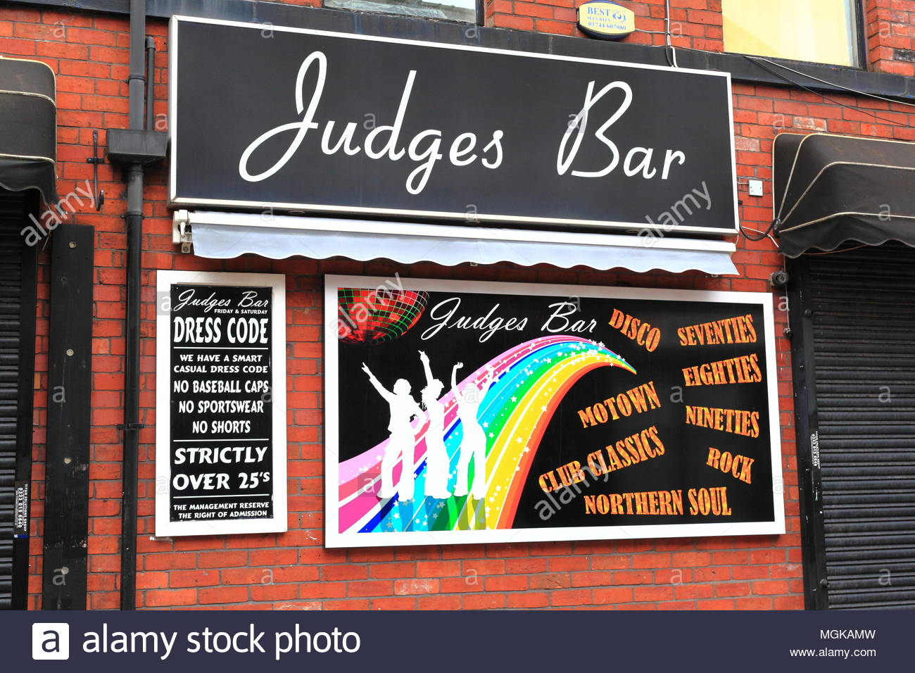 The Front Of Judges Bar At Stalybridge Cheshire Advertising 'What's On' With Warning Of Dress Code April 2018 - Stock Image