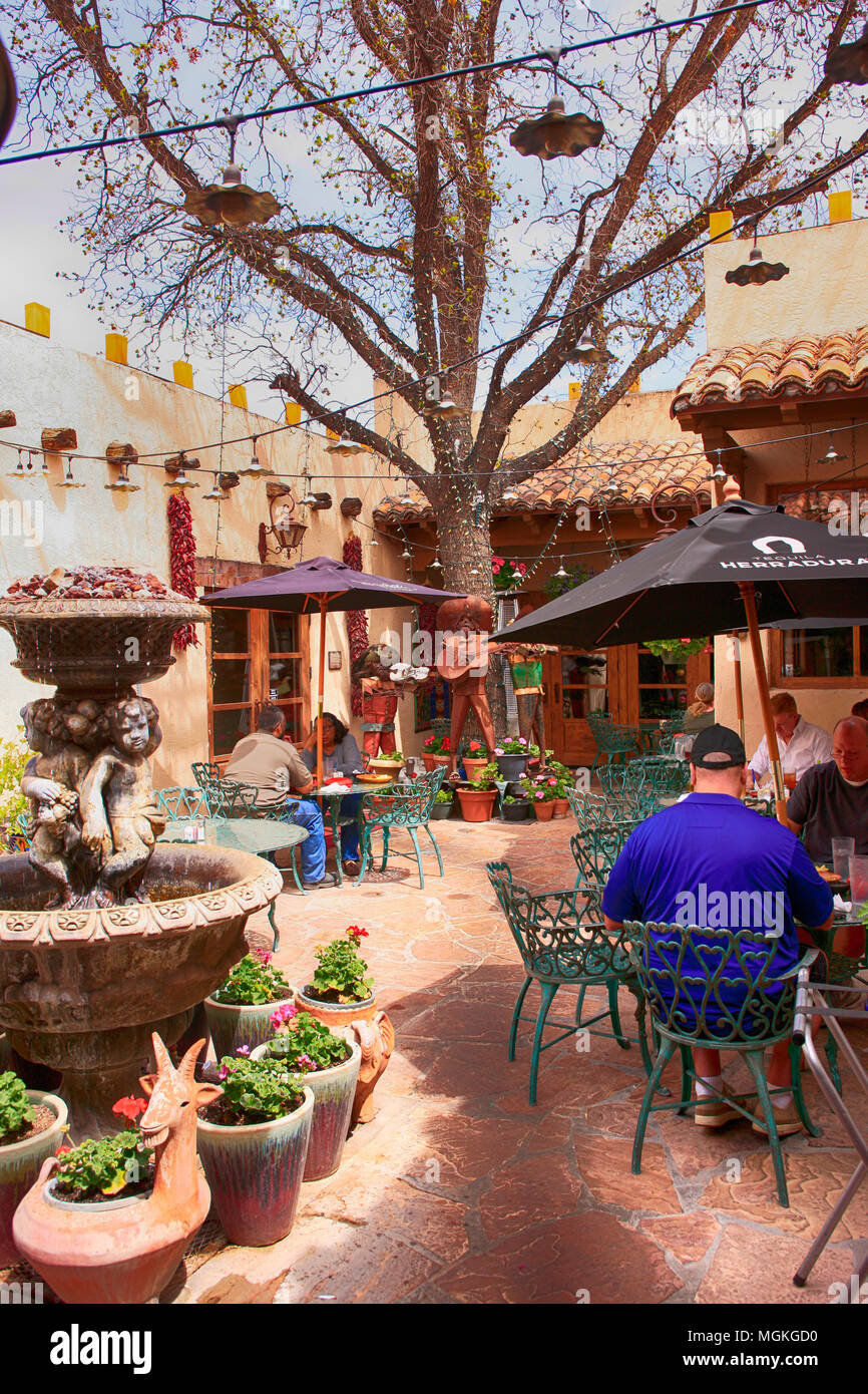 People enjoying the food in the courtyard at La Posta De Mesilla Restaurant in Las Cruces NM - Stock Image