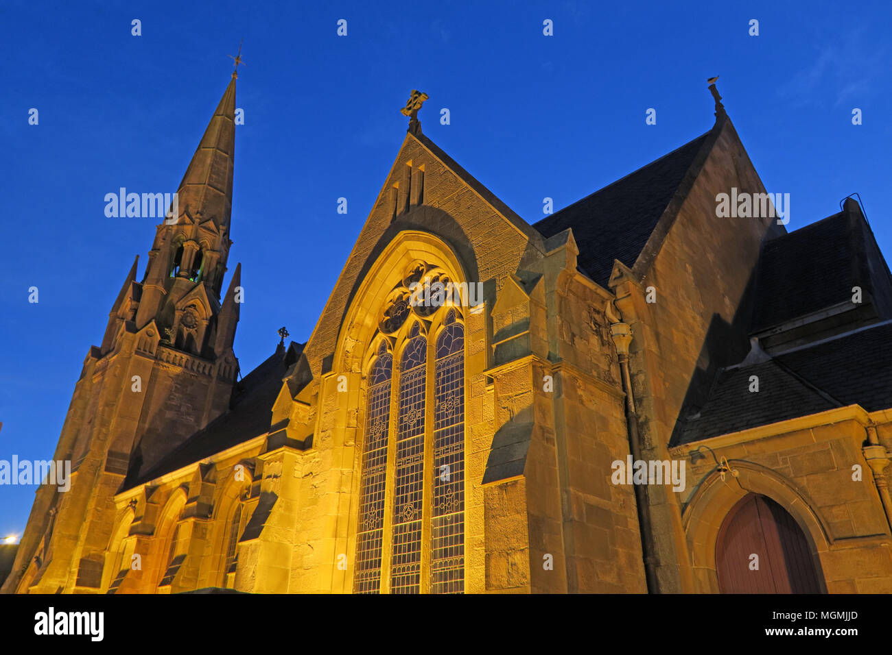 West Parish Church of Scotland, 30 Burnbank Road, West Hamilton, ML3 9AA at night - Stock Image